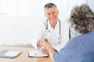 elderly woman talking to a doctor