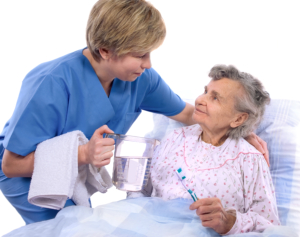 caregiver assists the elderly woman for bathing